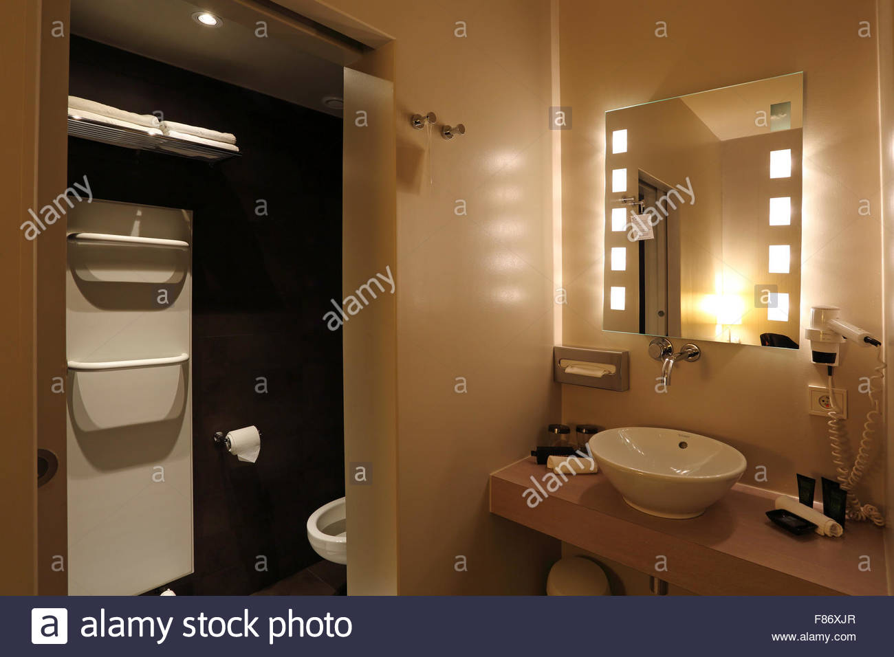 Bathroom and wash basin at the Hotel Harmony in central Ghent Stock ...