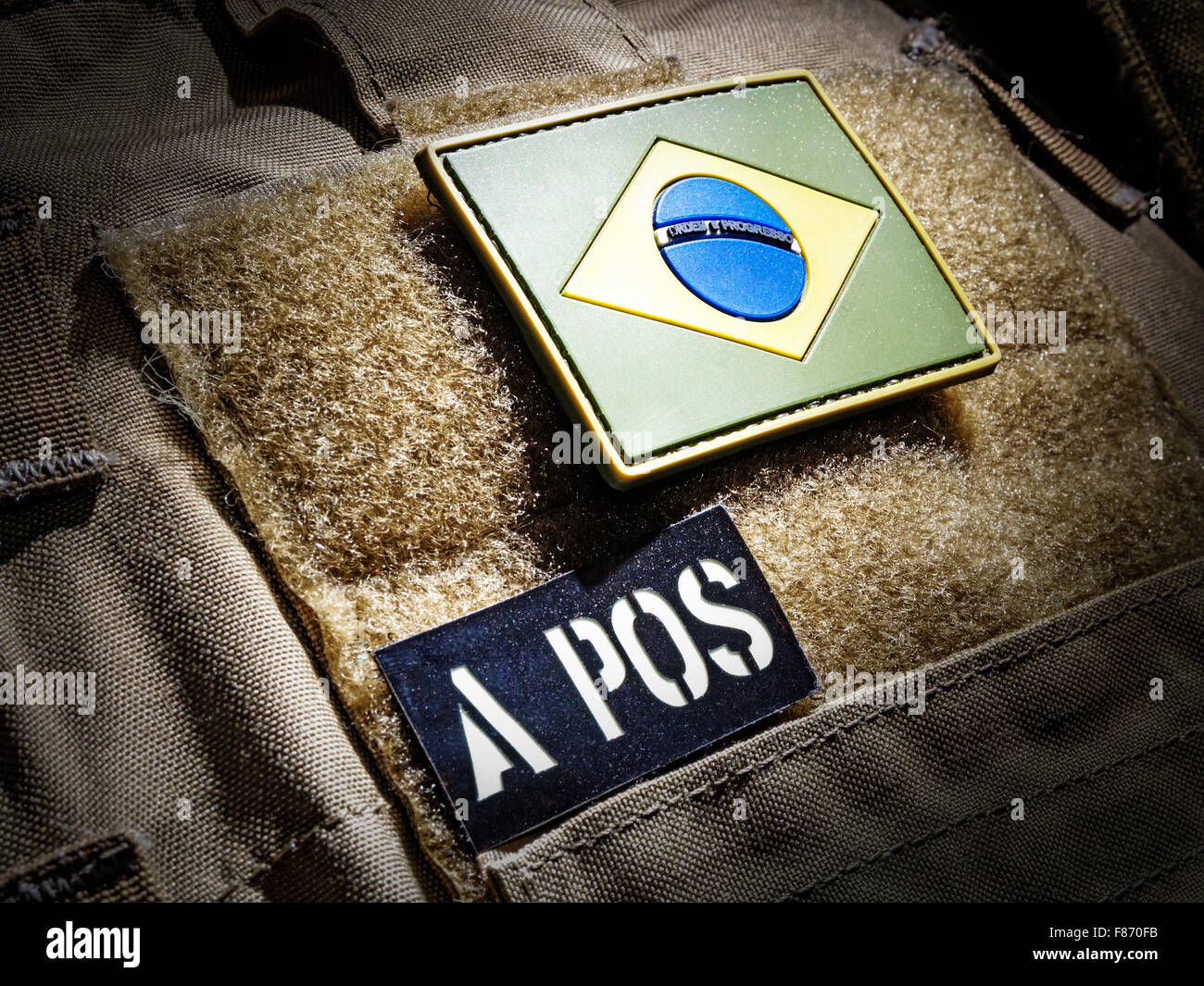 Brazilian flag and blood type IR patch on plate carrier - Stock Image