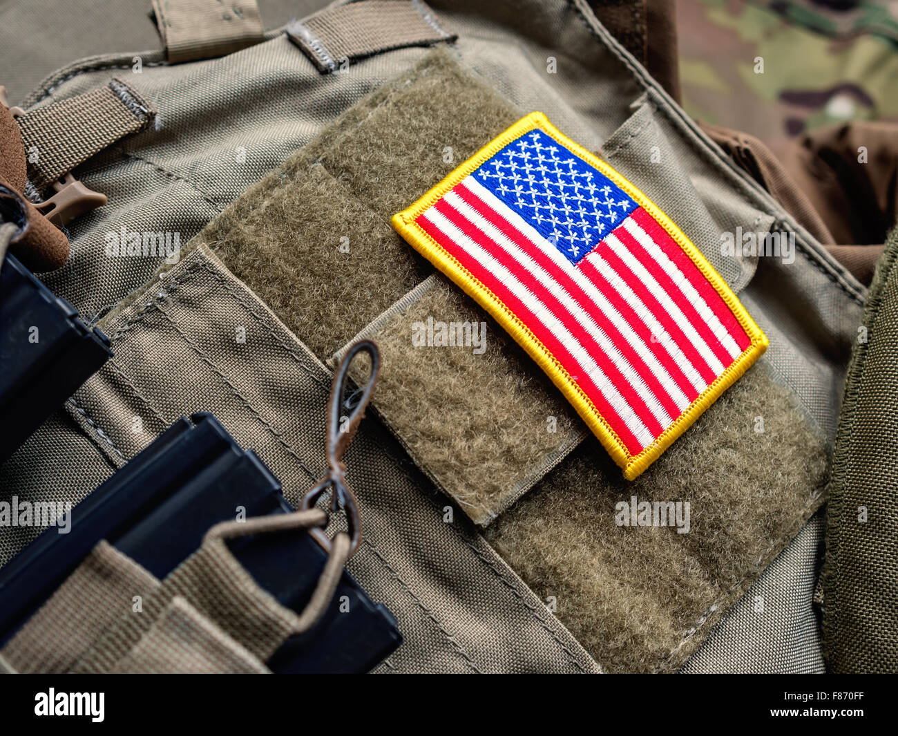 Plate carrier (bulletproof vest) with USA flag and M4 magazines Stock Photo