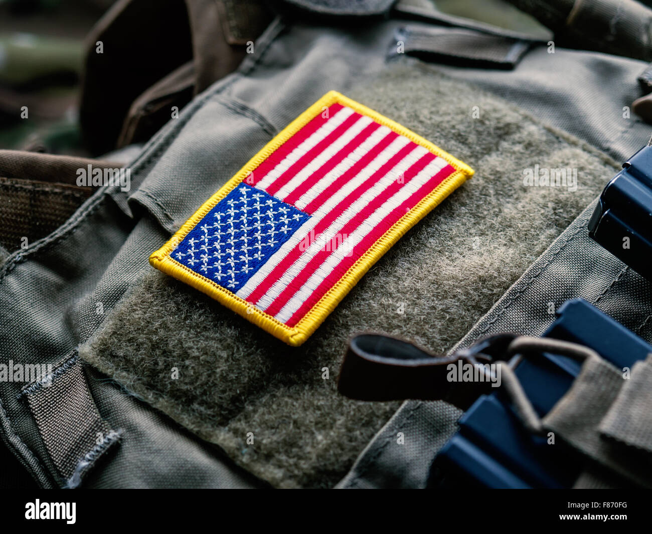 United States flag on the tactical bulletproof vest, selective focus - Stock Image