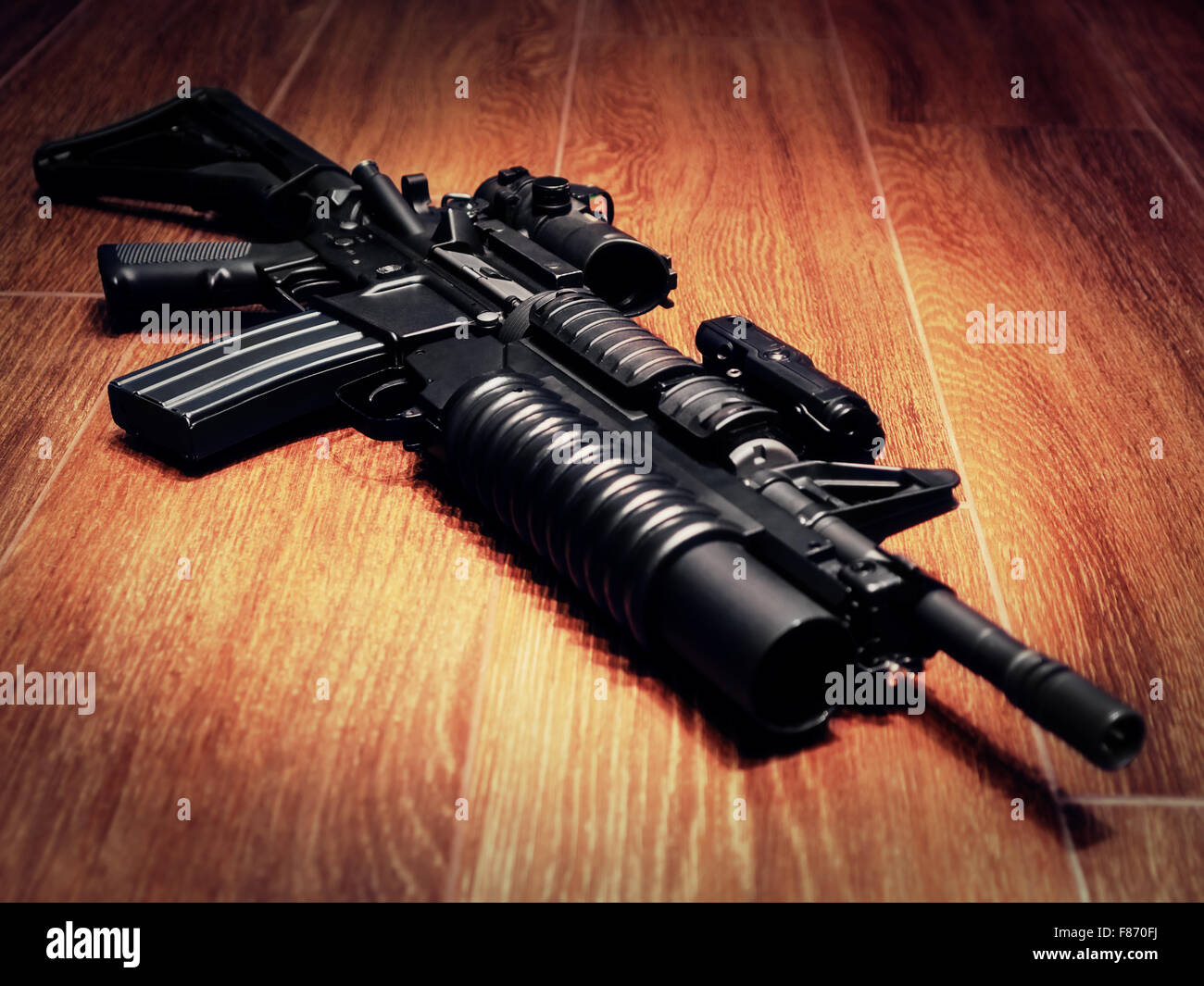 The Black Rifle with grenade launcher on the floor, selective focus - Stock Image