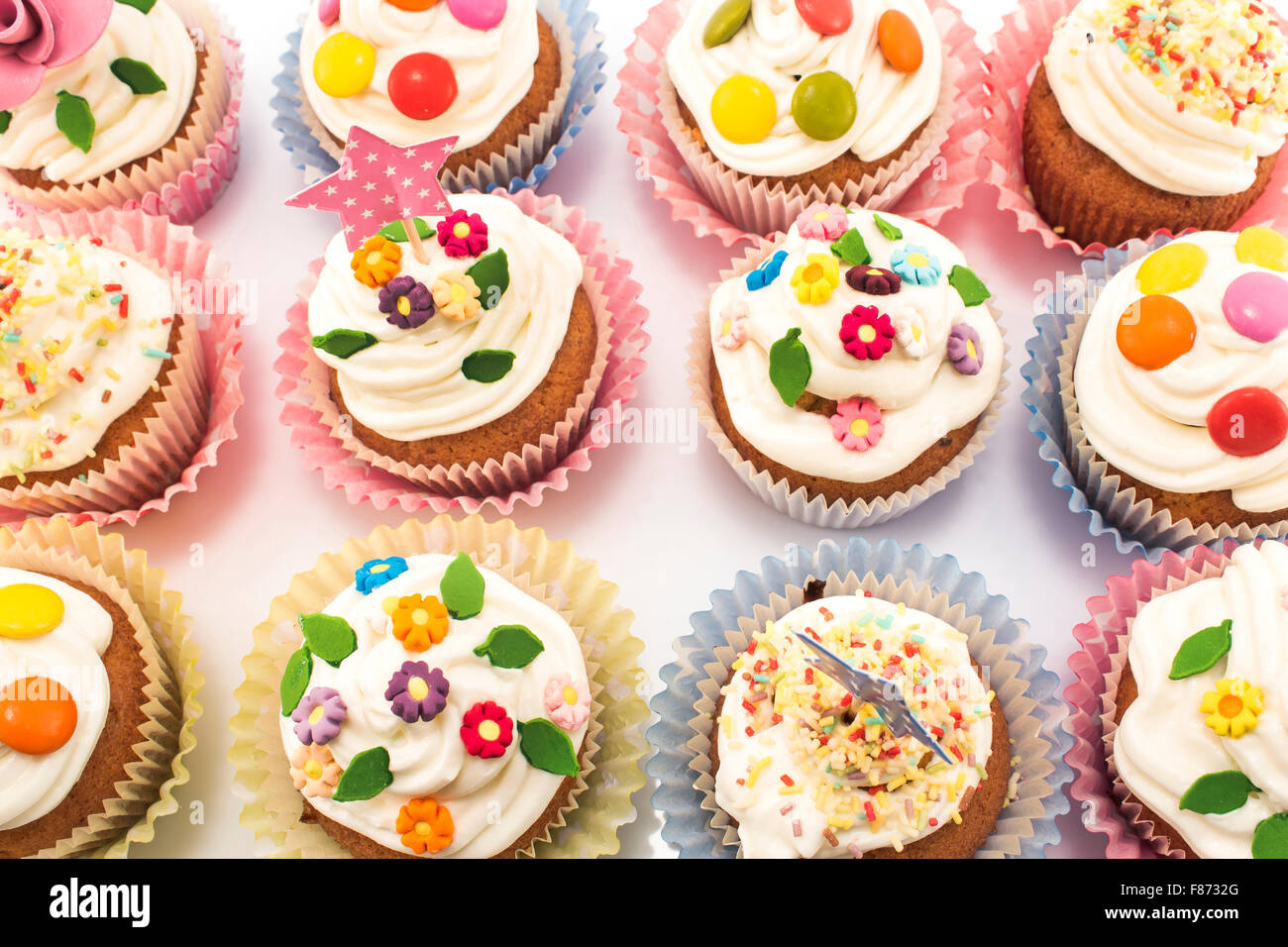 Cupcakes delicious and colorful decorated. Stock Photo