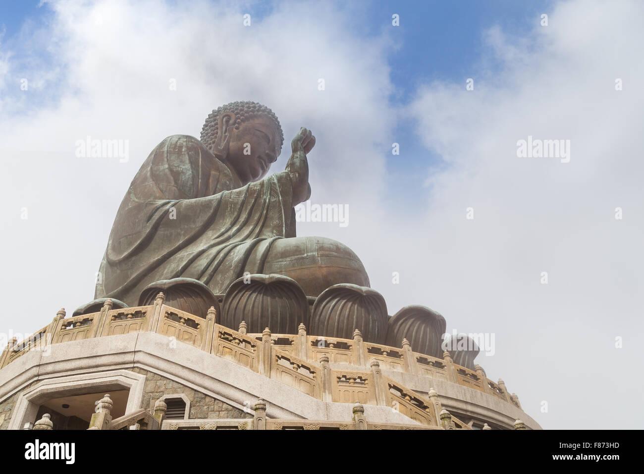 Tian Tan Buddha or Big Buddha statue in Lantau Island, Hong Kong, China, viewed from below. - Stock Image