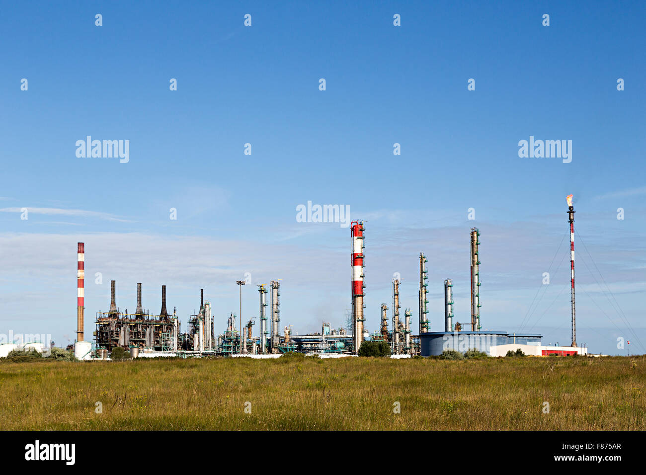 Burning off gas at industrial complex, Dunkirk - Stock Image