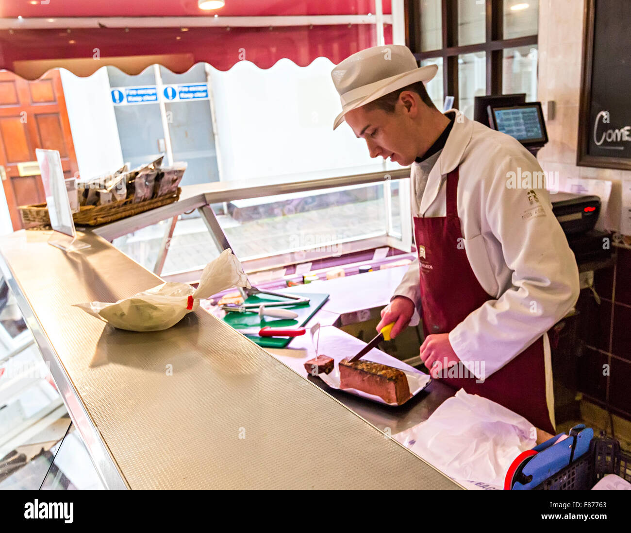 Butcher cutting pate from block, Abergavenny, Wales, UK - Stock Image