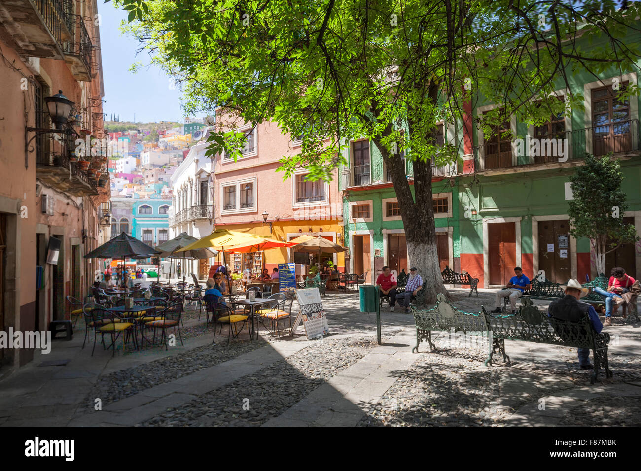 People relaxing in one of Guanajuato, Mexico's colorful plazas. - Stock Image