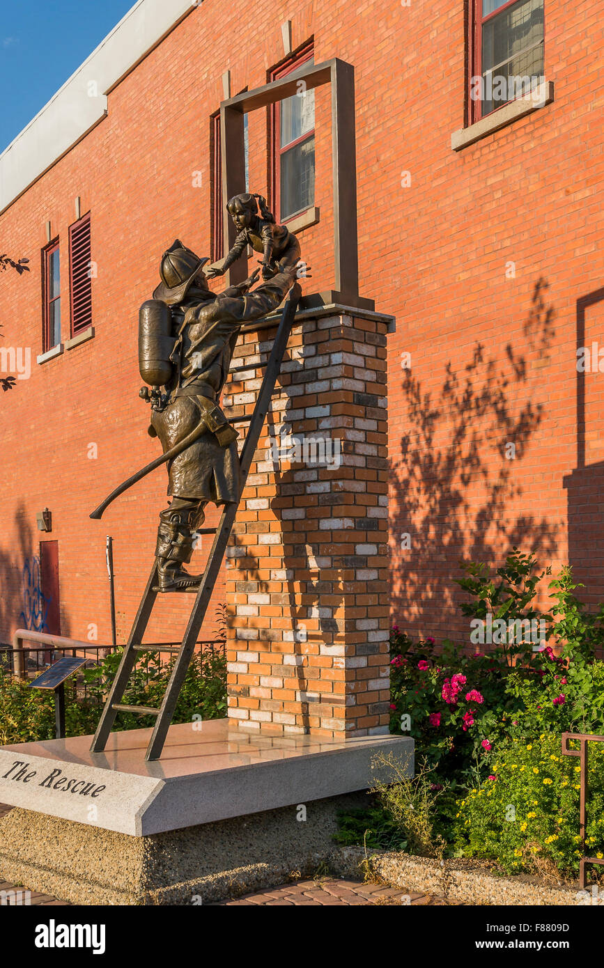 The Rescue sculpture Fireman rescuing young girl, Edmonton, Alberta, canada - Stock Image