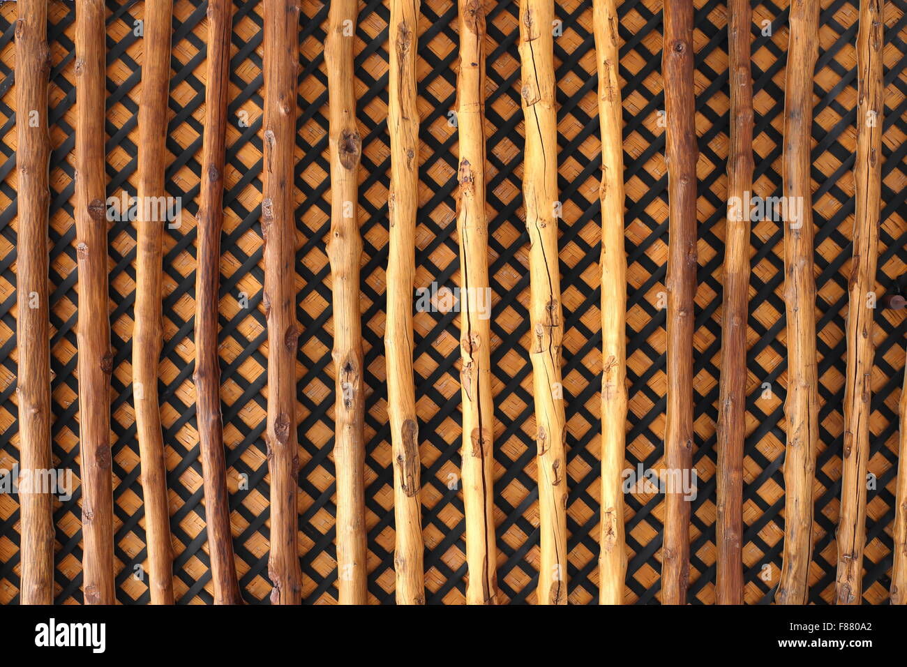Ceiling made out of palm trunk beams with plaited palm fronds and matting behind, Khalaf House, Manama, Kingdom - Stock Image