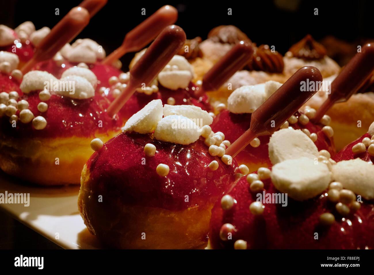 Elegantly traditional Sufganiyot deep fried round doughnut eaten during Hanukkah Jewish feast - Stock Image