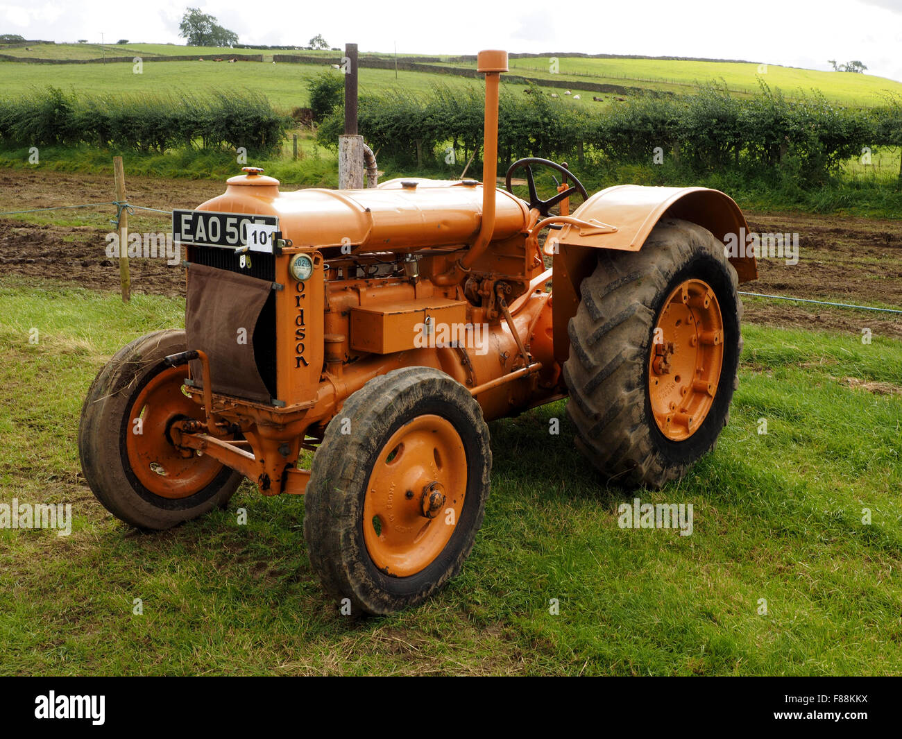 classic brown vintage tractor resplendent in show field at agricultural show - Stock Image