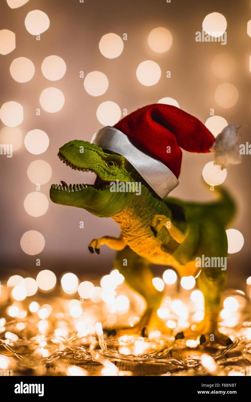 Dinosaur Christmas.Dinosaur With Santa Hat During Christmas Stock Photo