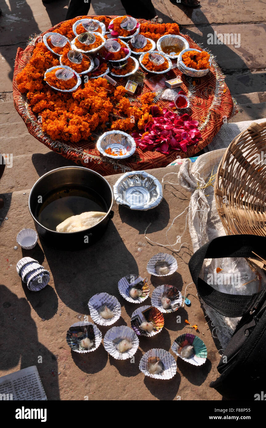Hindu devotees in India use marigold , rose flowers, cotton, ghee, red powder, rice in all religious ceremonies, Stock Photo