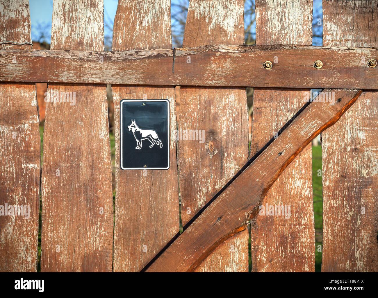 Beware of dog sign on wooden door. - Stock Image