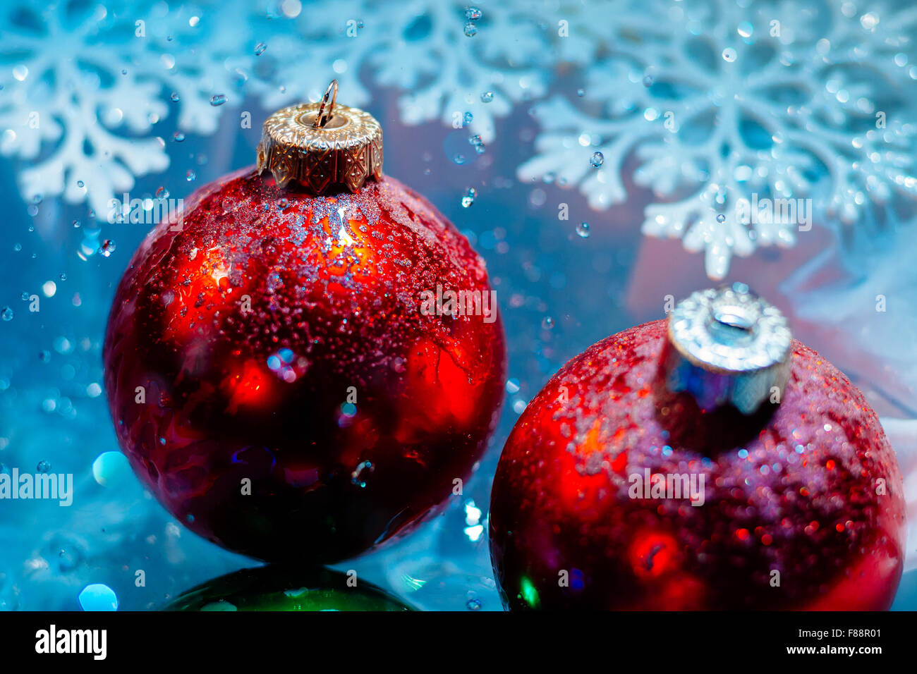 fancy new year frozen balls with ice water drops bokeh on snowflakes winter background wallpaper