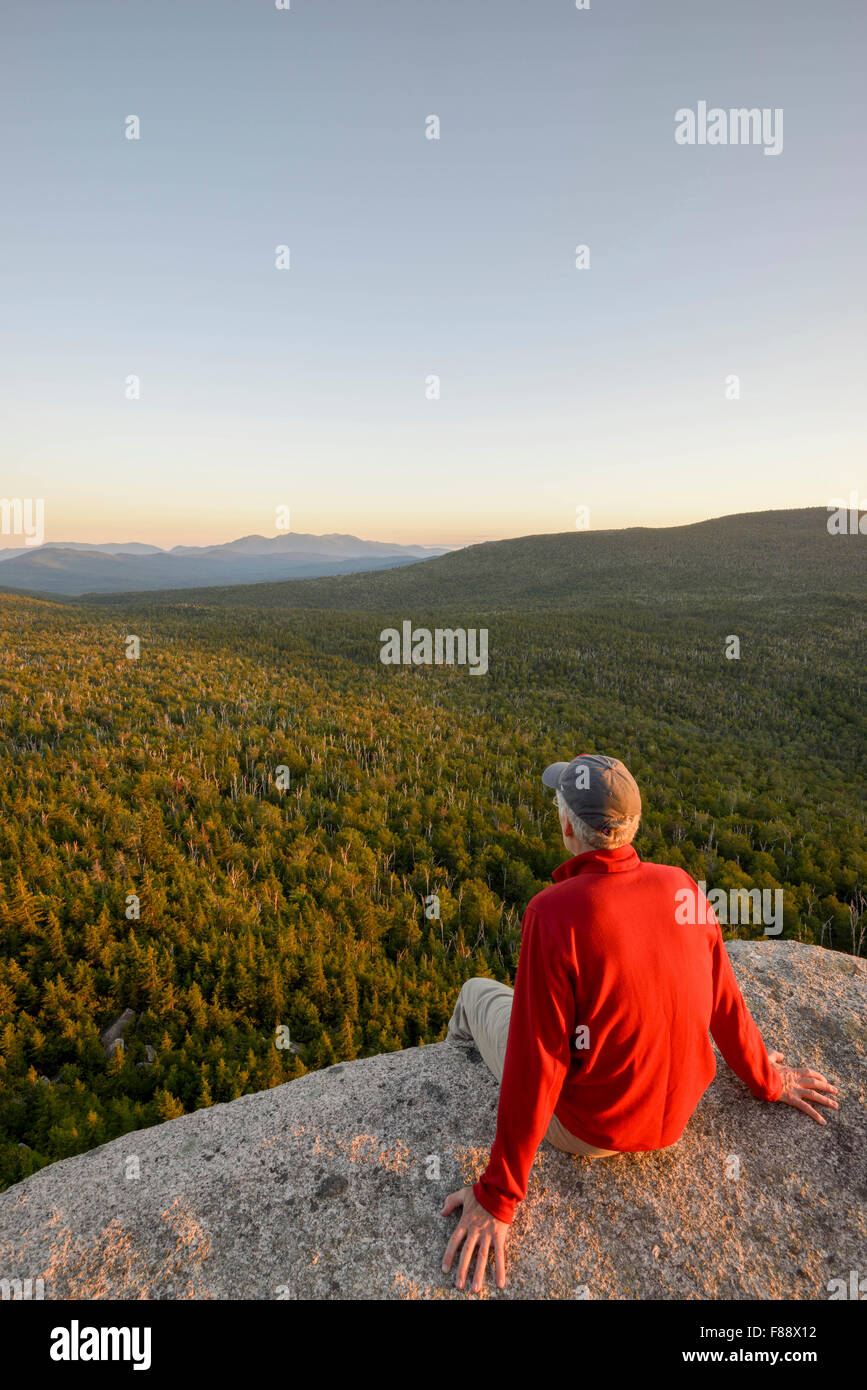 Hiker on Roger's Ledge at sunset, White Mountain National Forest, New Hampshire - Stock Image