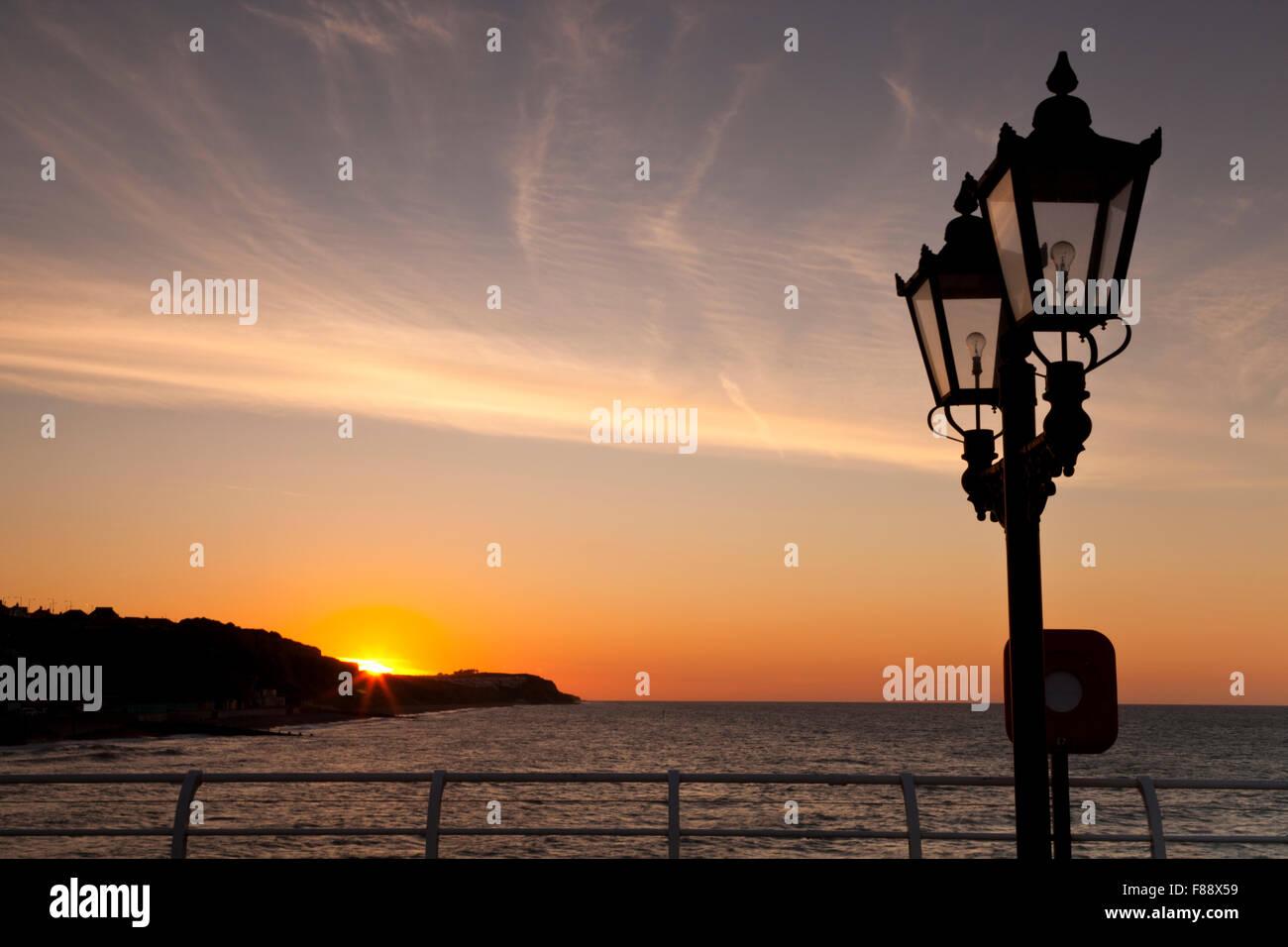 Sunset over Cromer Cliffs, Norfolk England UK, from Cromer Pier - Stock Image