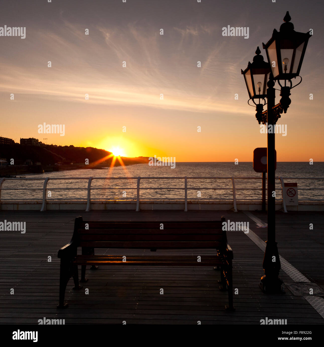 Sunset over cliffs at Cromer from the pier. Norfolk England UK. - Stock Image