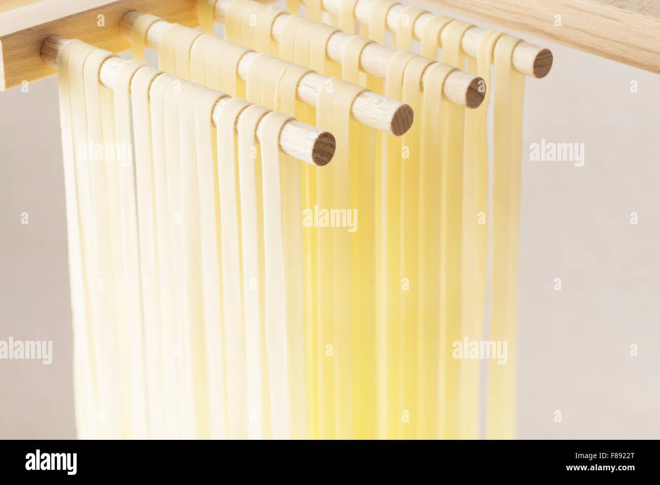Fresh Tagliatelle pasta drying - Stock Image