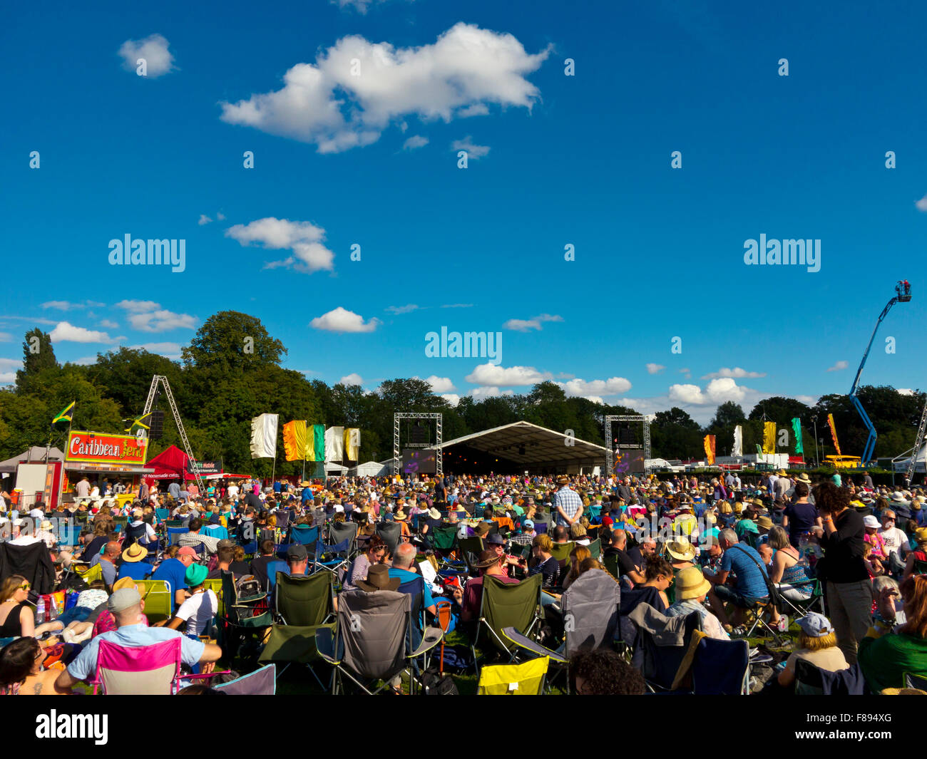 Crowd enjoying a performance at the Cambridge Folk Festival held every summer at Cherry Hinton in Cambridgeshire - Stock Image