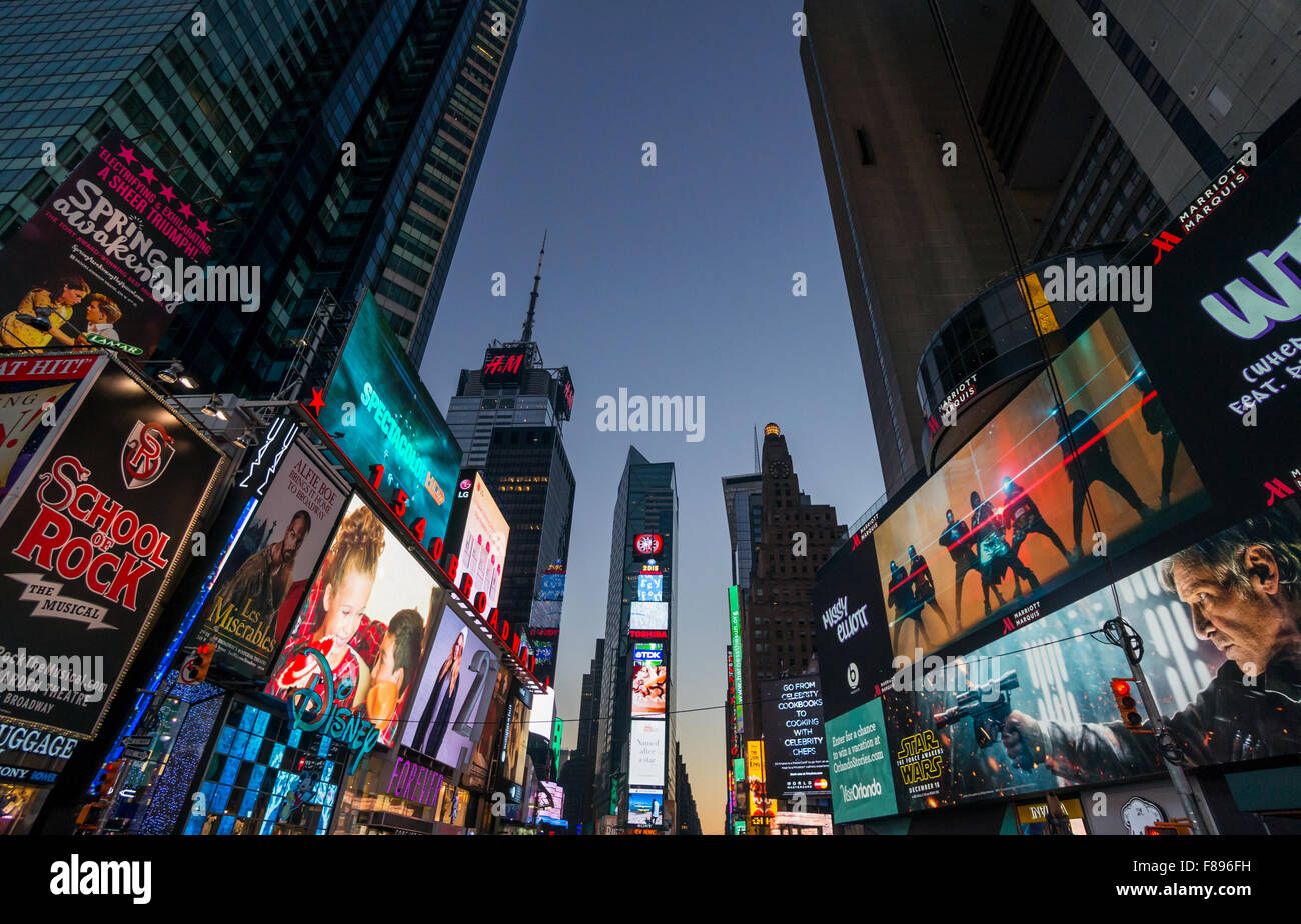 Times Square at night showing giant digital screens - Stock Image