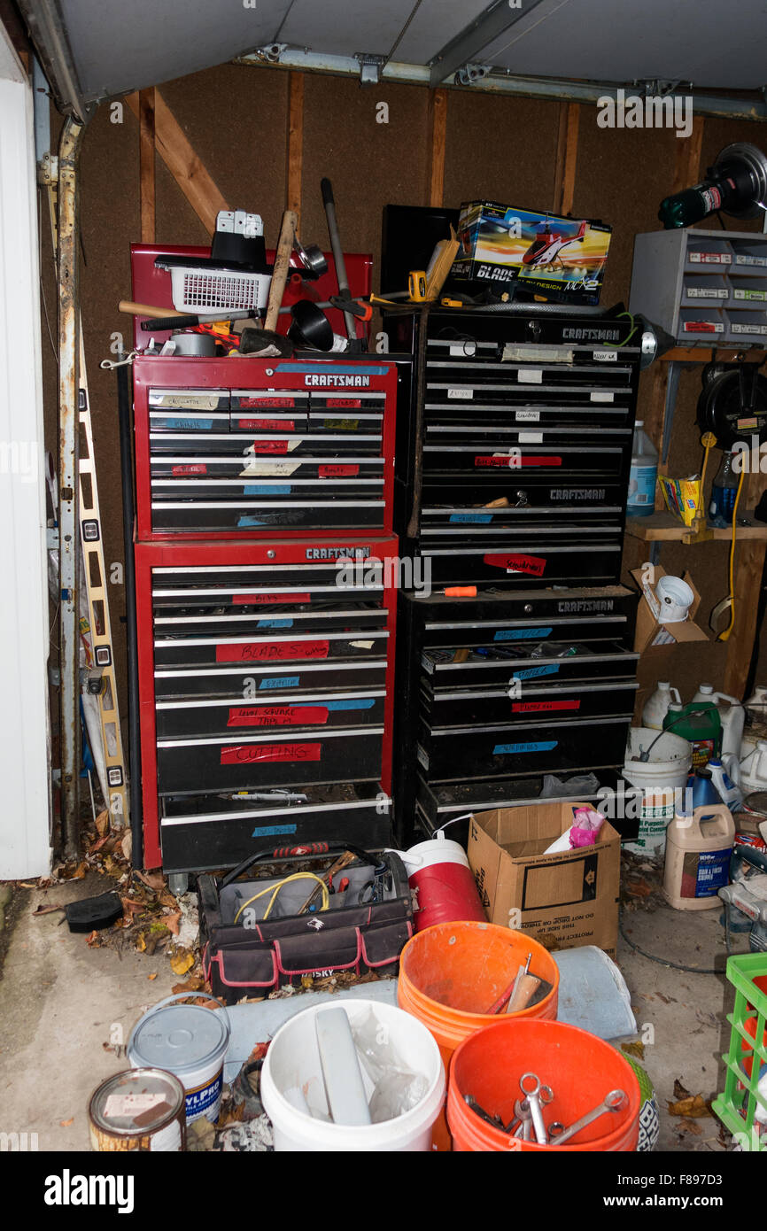 Working man's garage with two tall sets of rolling storage cabinets with tool filled drawers. Downers Grove Illinois Stock Photo