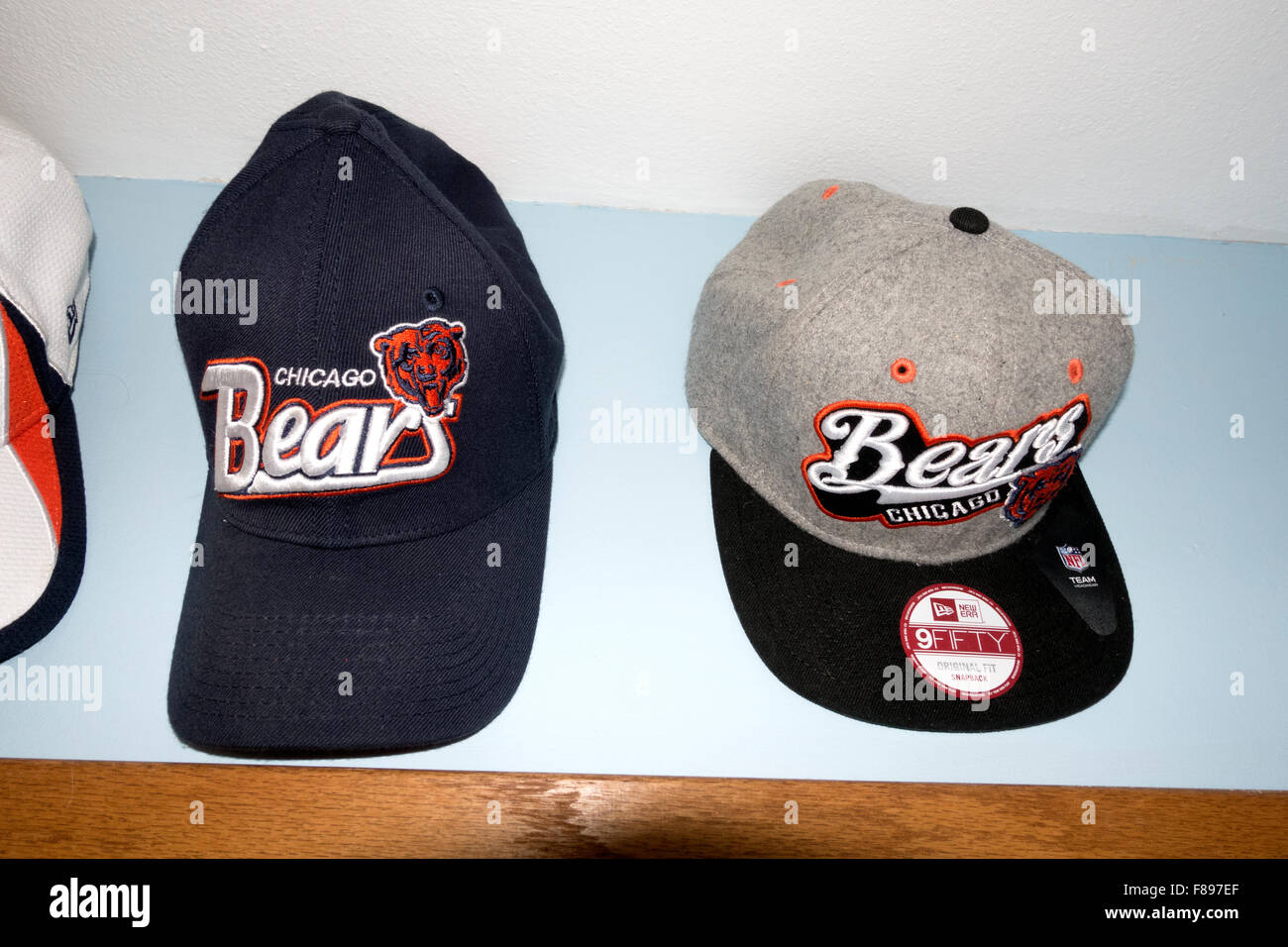 Chicago Bears NFL professional football team billed caps displayed on the den wall. Downers Grove Illinois IL USA - Stock Image