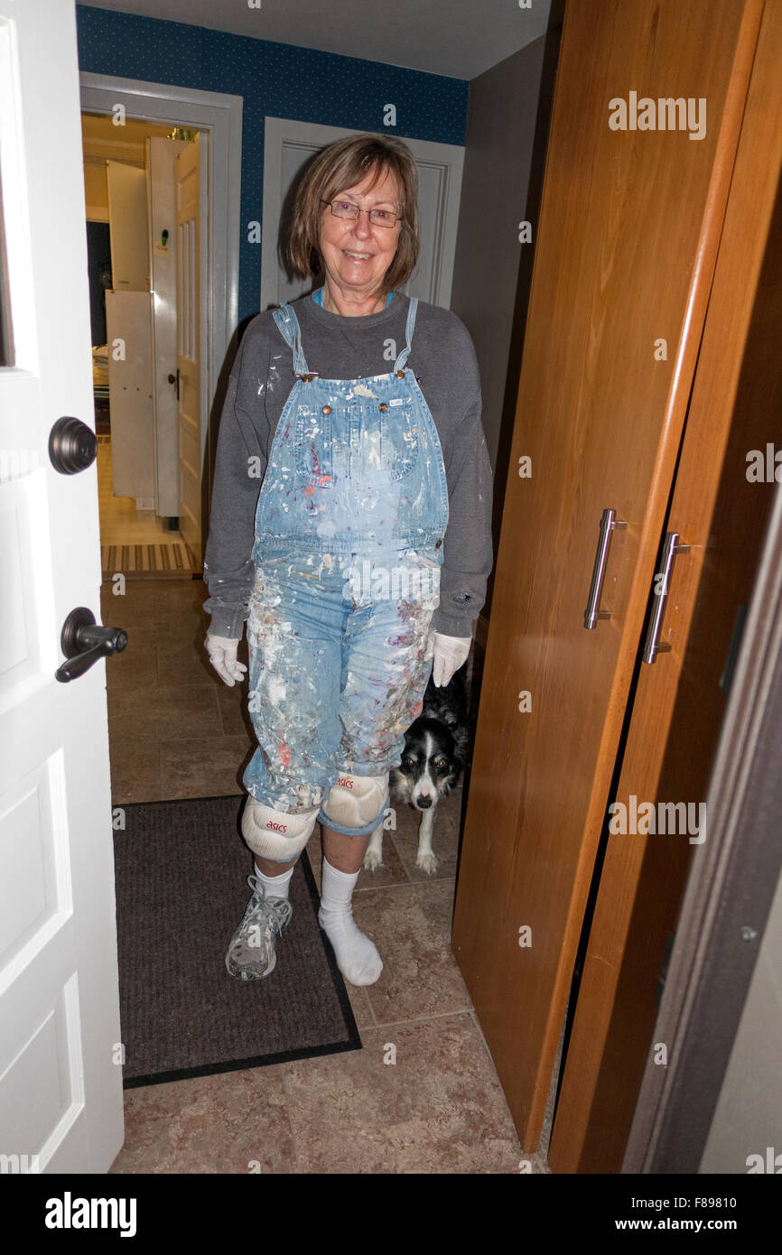 Just interrupted my sister from painting her under counter cupboard wearing knee pads, bibs & dog. Clitherall - Stock Image