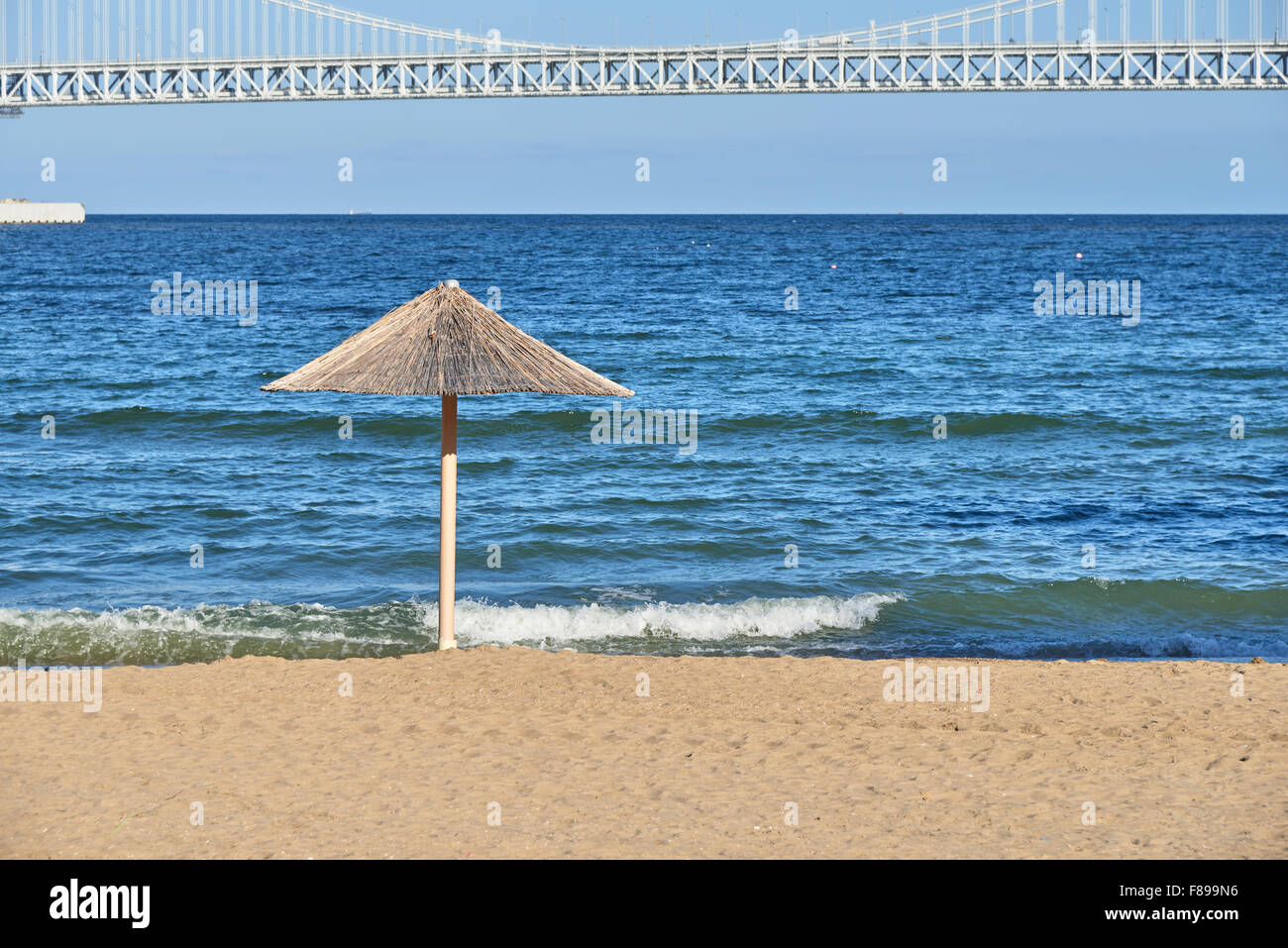 straw umbrella at Gwangalli beach. Gwangan beach is located west of Haeundae beach in Busan and famous for the Gwangan - Stock Image