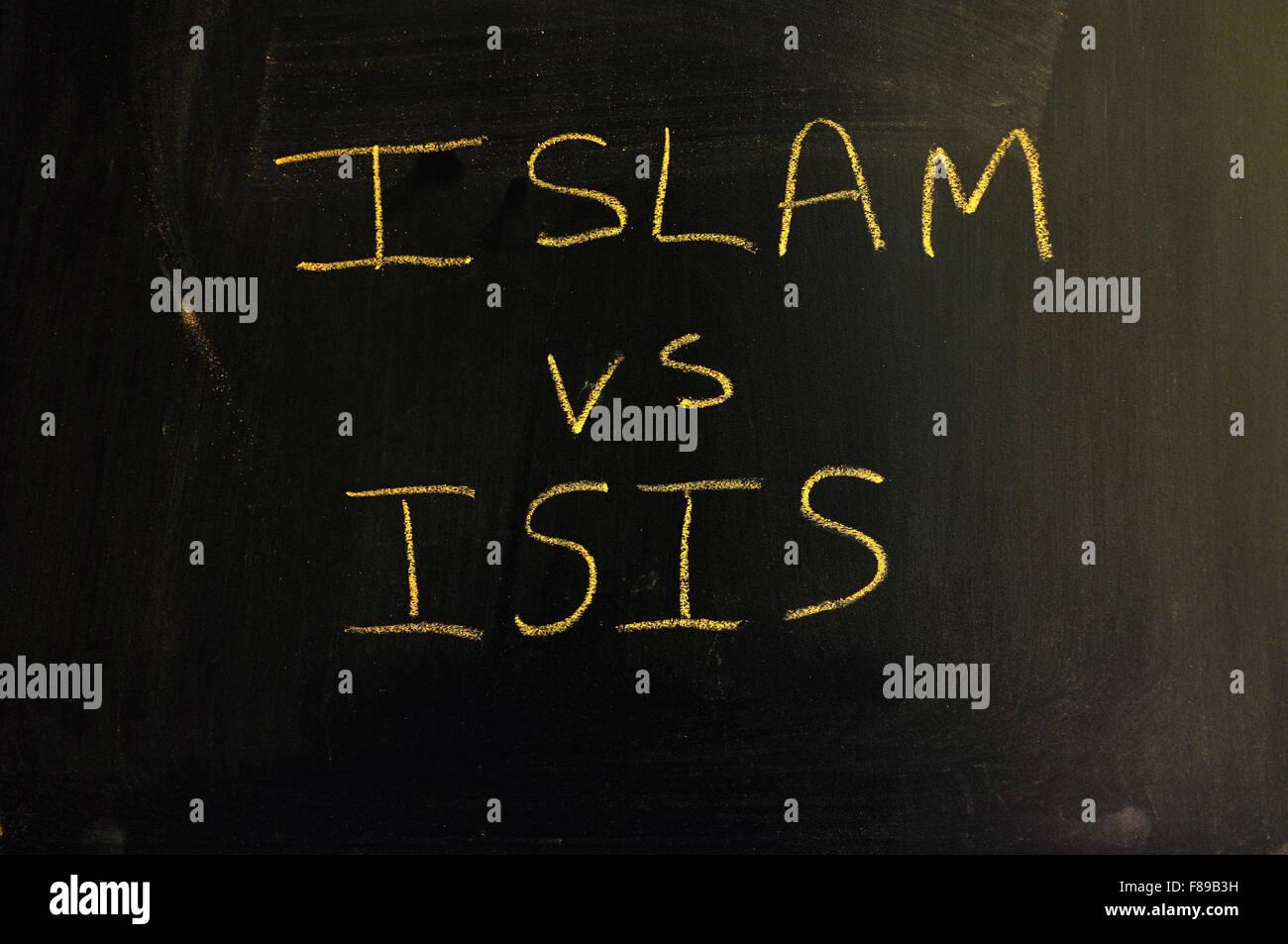 Islam vs ISIS written on a blackboard in chalk. Stock Photo