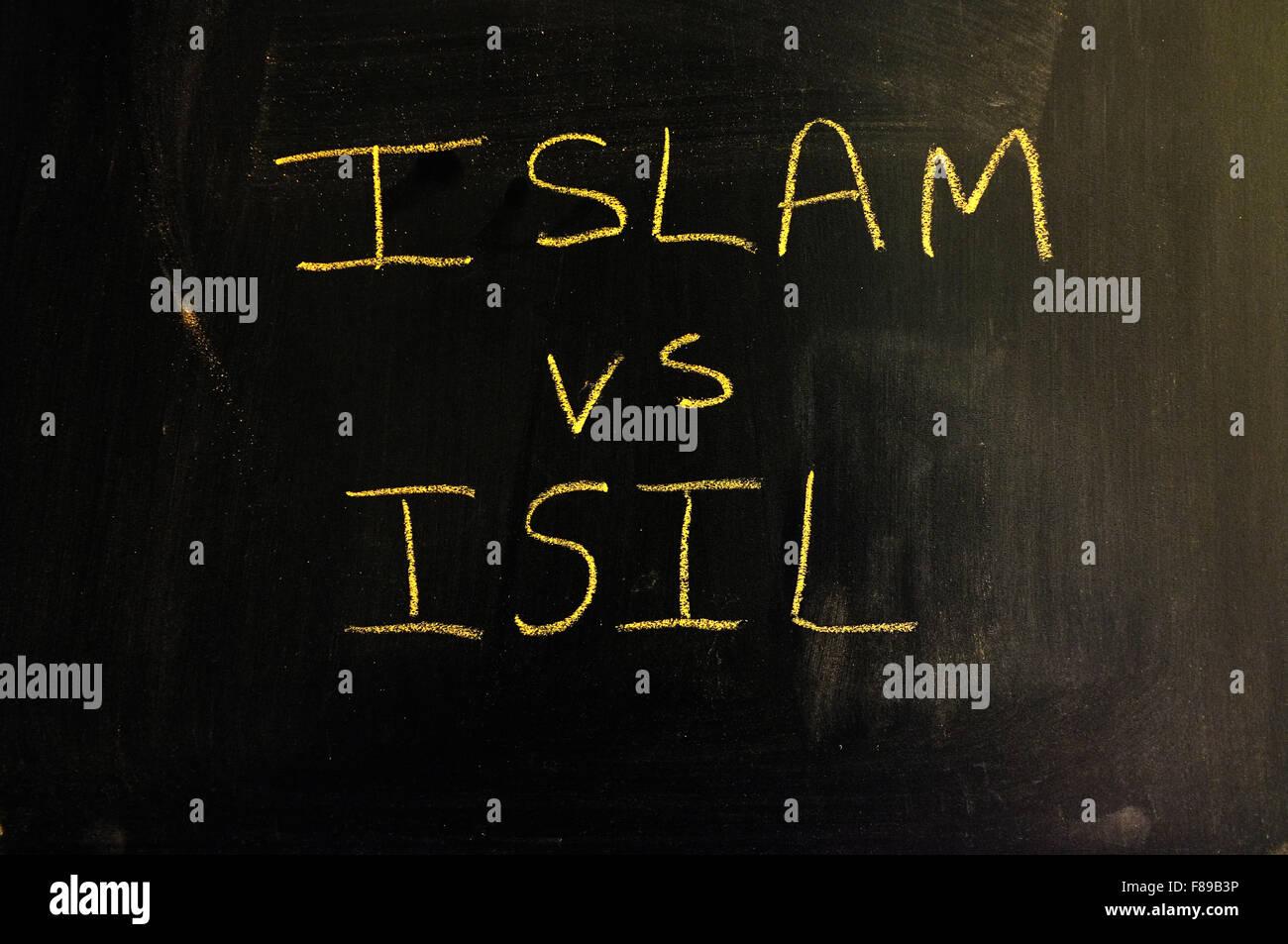 Islam vs ISIL written on a blackboard in chalk. - Stock Image