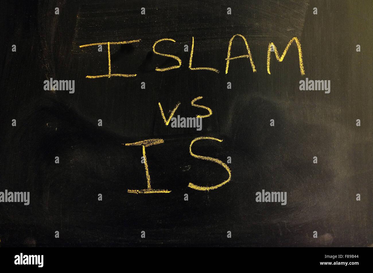 Islam vs IS written on a blackboard in chalk. - Stock Image