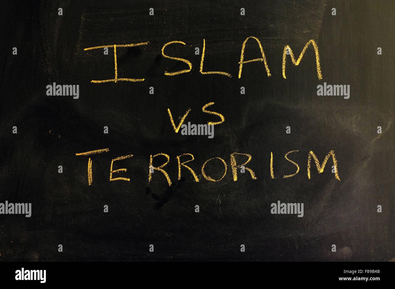 Islam vs Terrorism written on a blackboard in chalk. - Stock Image