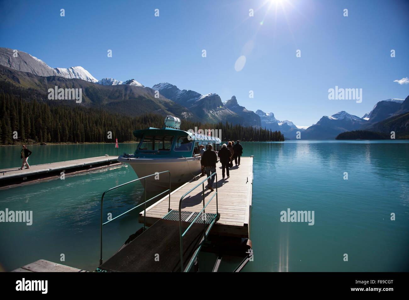 JASPER, ALBERTA - SEPTEMBER 6, 2012: Tourists depart on a chartered boat tour of Maligne Lake in Jasper National - Stock Image