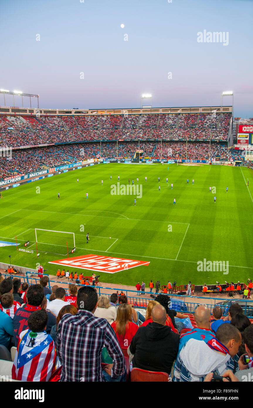People in Vicente Calderon stadium during a football match. Madrid, Spain. - Stock Image