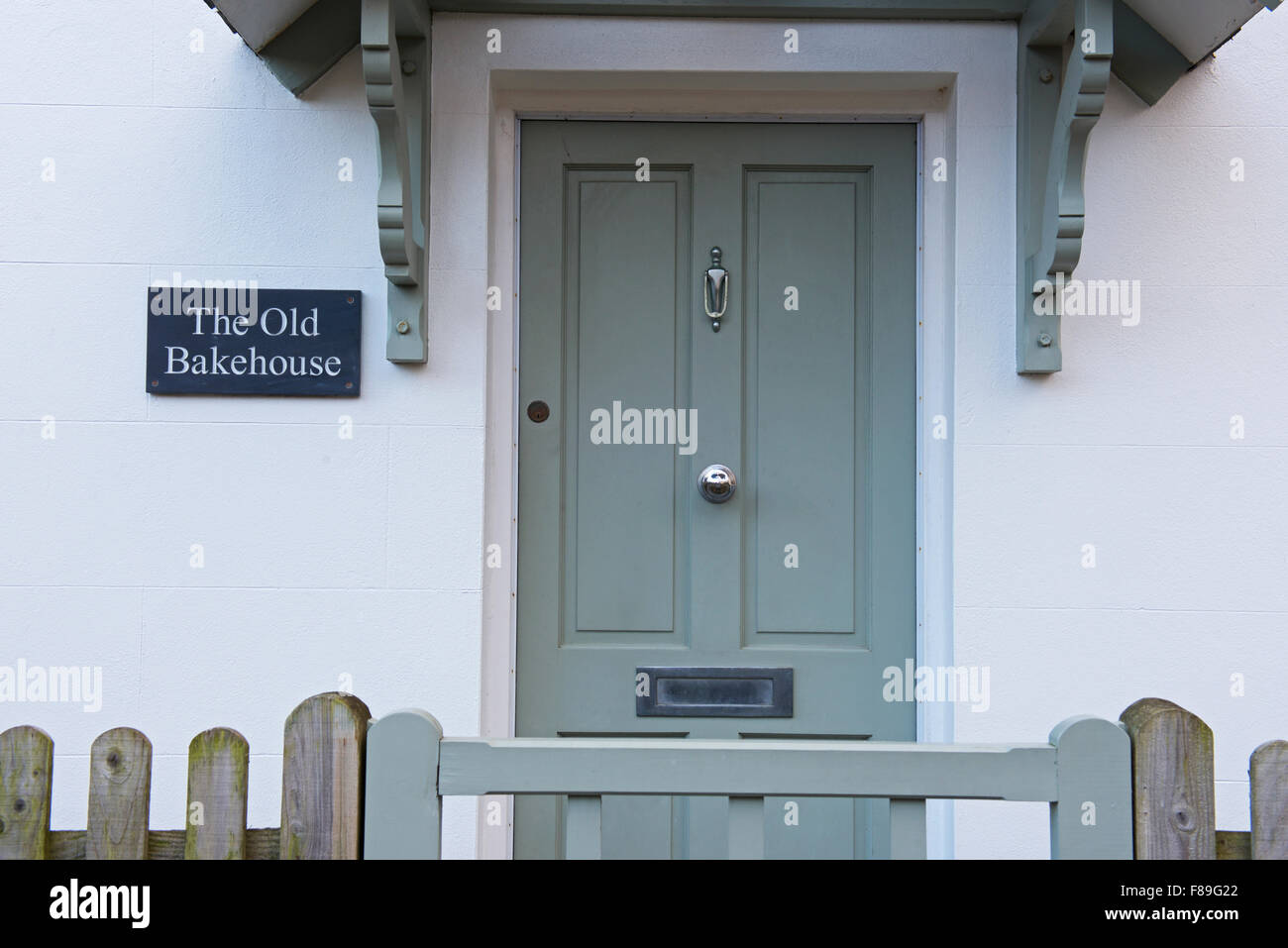 House with sign - The Old Bakehouse - in the village of Bosham, Sussex, England UK - Stock Image