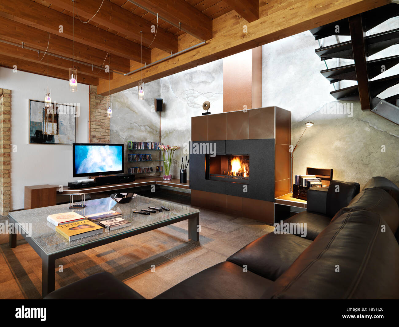 modern fireplace and leather sofa in the modern living room - Stock Image