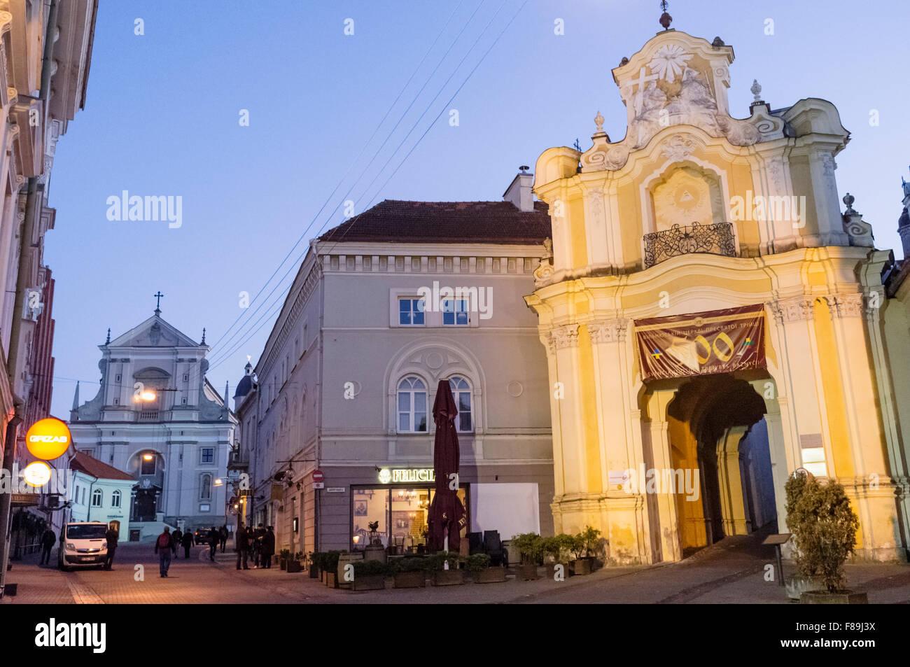 Basilian monastery gates illuminated at dusk. Vilnius, Lithuania, Europe - Stock Image