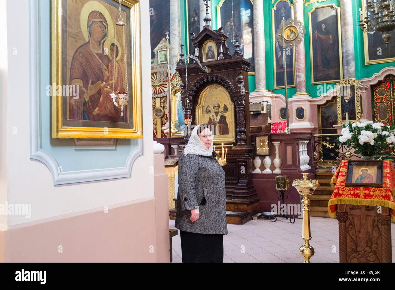 Woman inside the Orthodox Church of the Holy Spirit. Vilnius, Lithuania, Europe - Stock Image