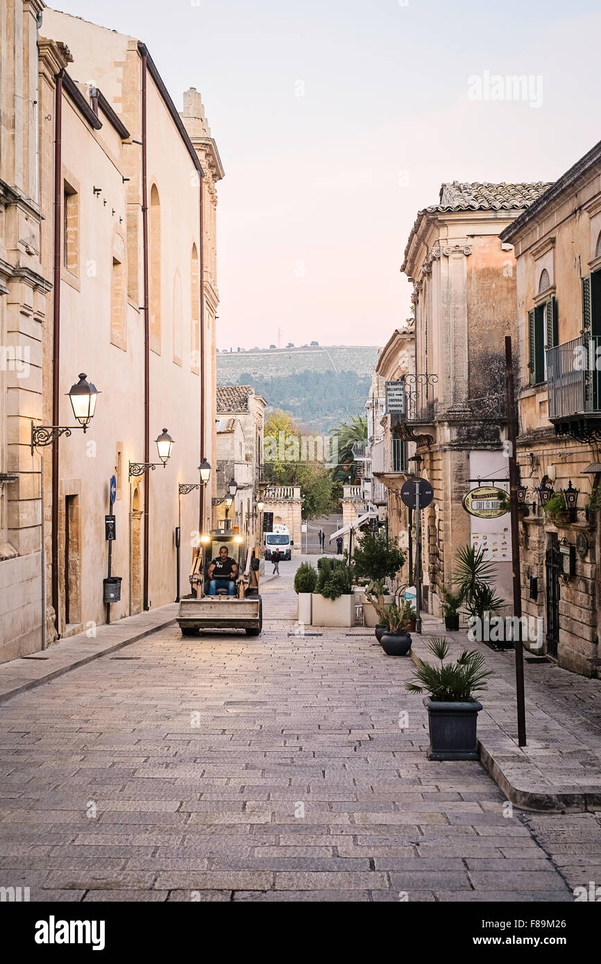 Street in Ragusa with building truck driving down it. - Stock Image