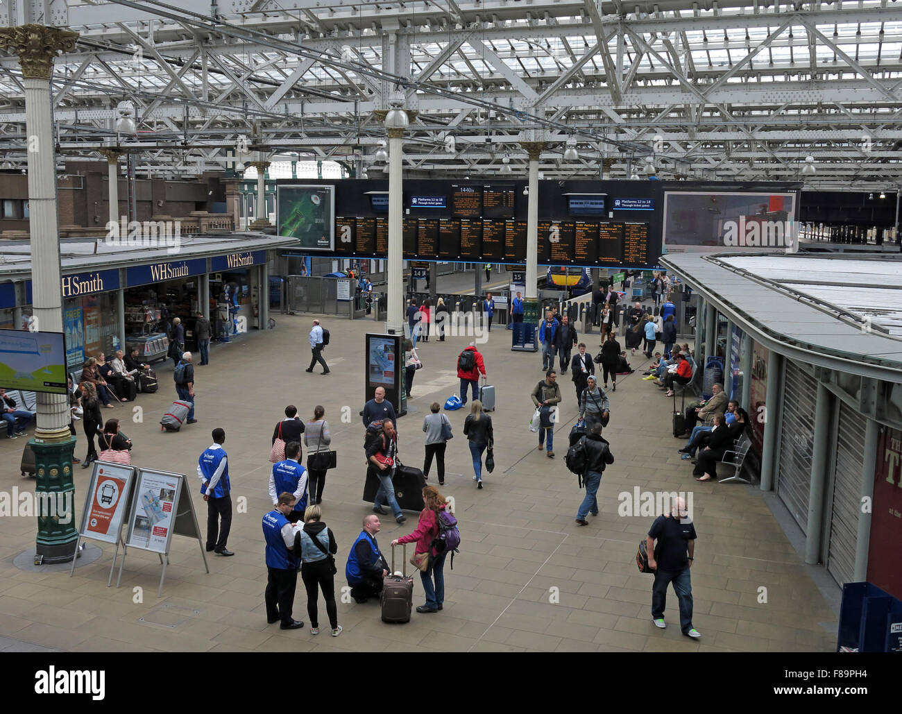 Waverley Railway Station, Edinburgh, Scotland with passengers near departure boards - Stock Image