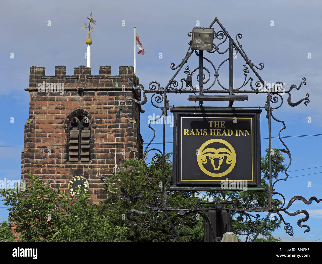 Rams Head inn sign & St Wilfrids Church tower ,Grappenhall,Warrington,Cheshire,England,UK - Stock Image