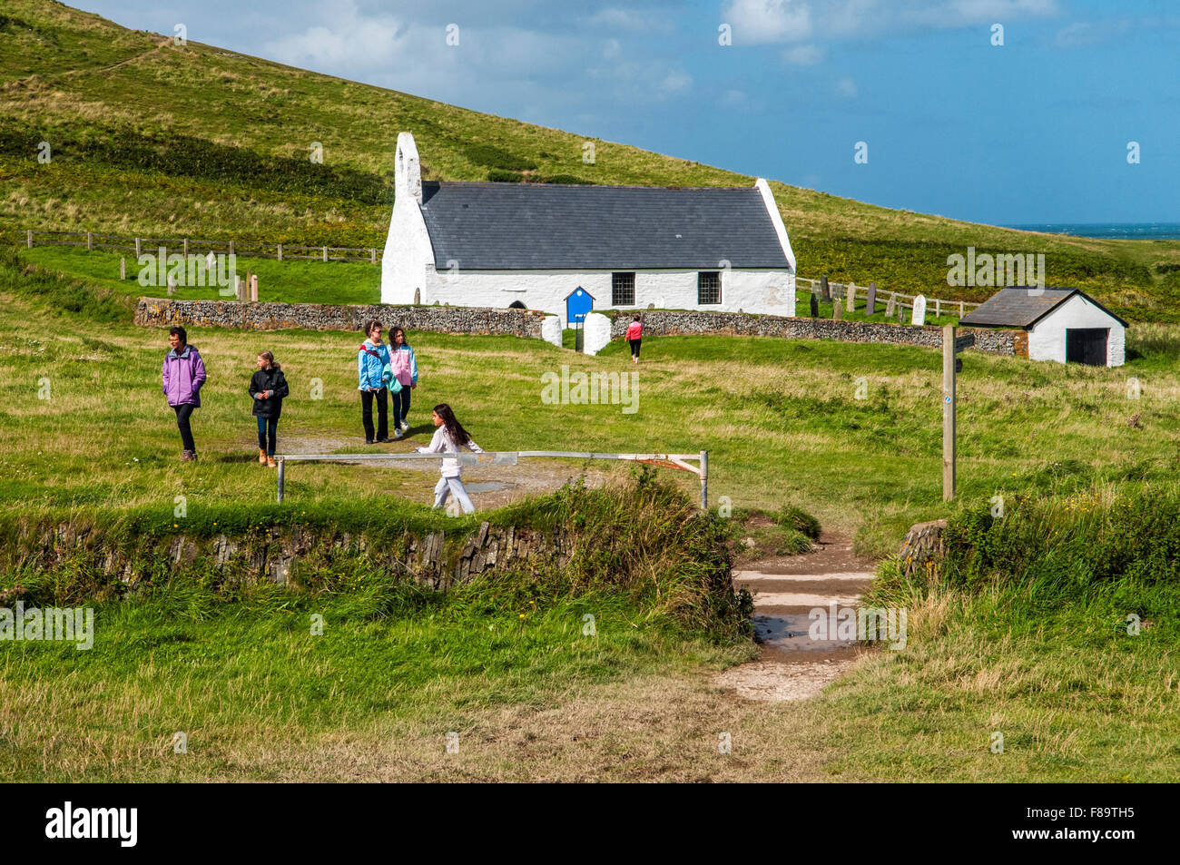 Mwnt Church on the Ceredigion, or Cardiganshire, Coast in West Wales, with visitors - Stock Image