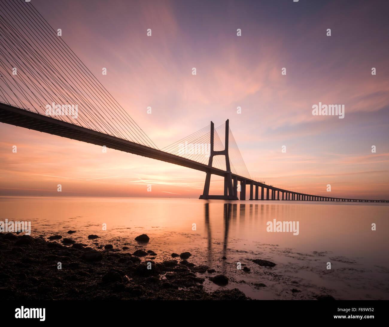Vasco da Gama Bridge at dawn, Lisbon, Portugal - Stock Image