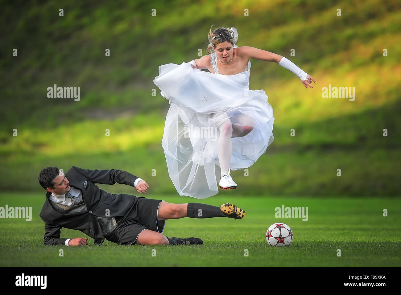 Brautpaar, Groom and bride, newlyweds are playing football after wedding  Alsmoos, Bavaria, Germany 8th November - Stock Image