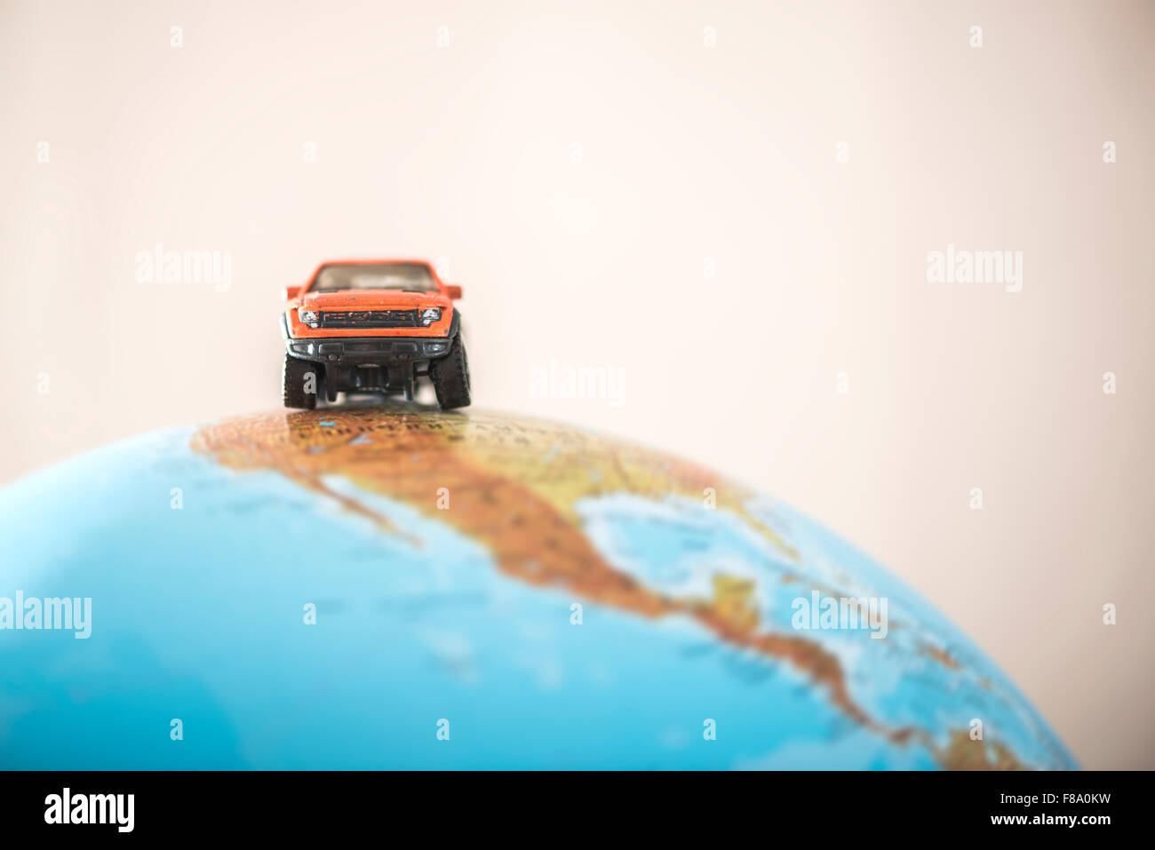 Offroad car on globe. Miniature concept - Stock Image