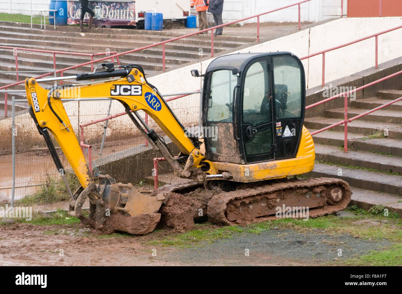 jcb mini digger earthmover movers earth diggers shovel hydraulic arm arms caterpillar track tracks tracked - Stock Image