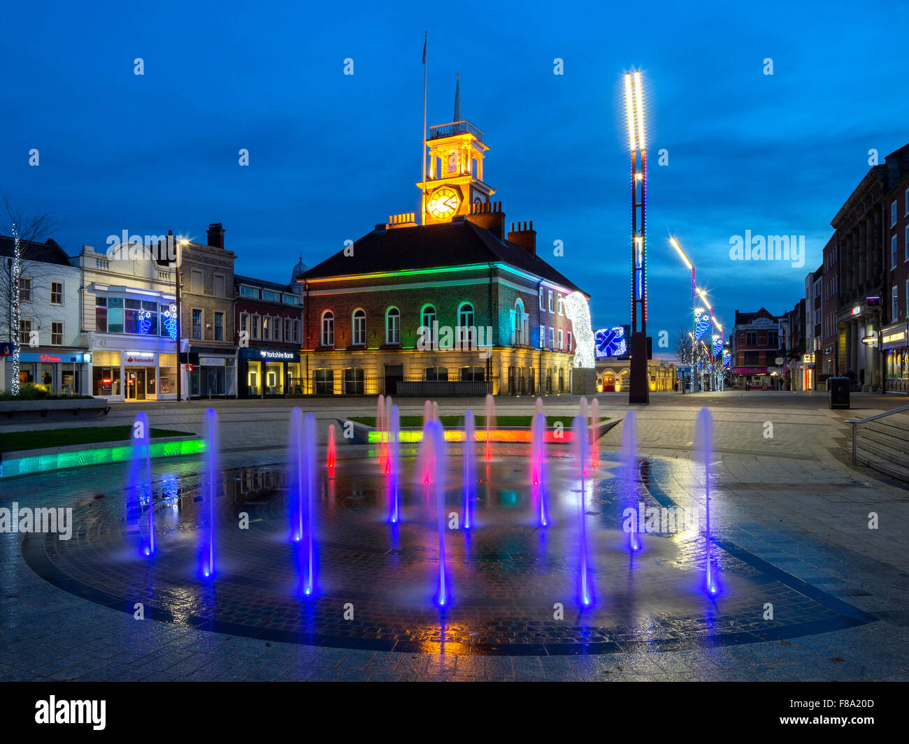 A view at dusk at Christmas of the Town Hall on the High Street in Stockton on Tees seen through the illuminated - Stock Image