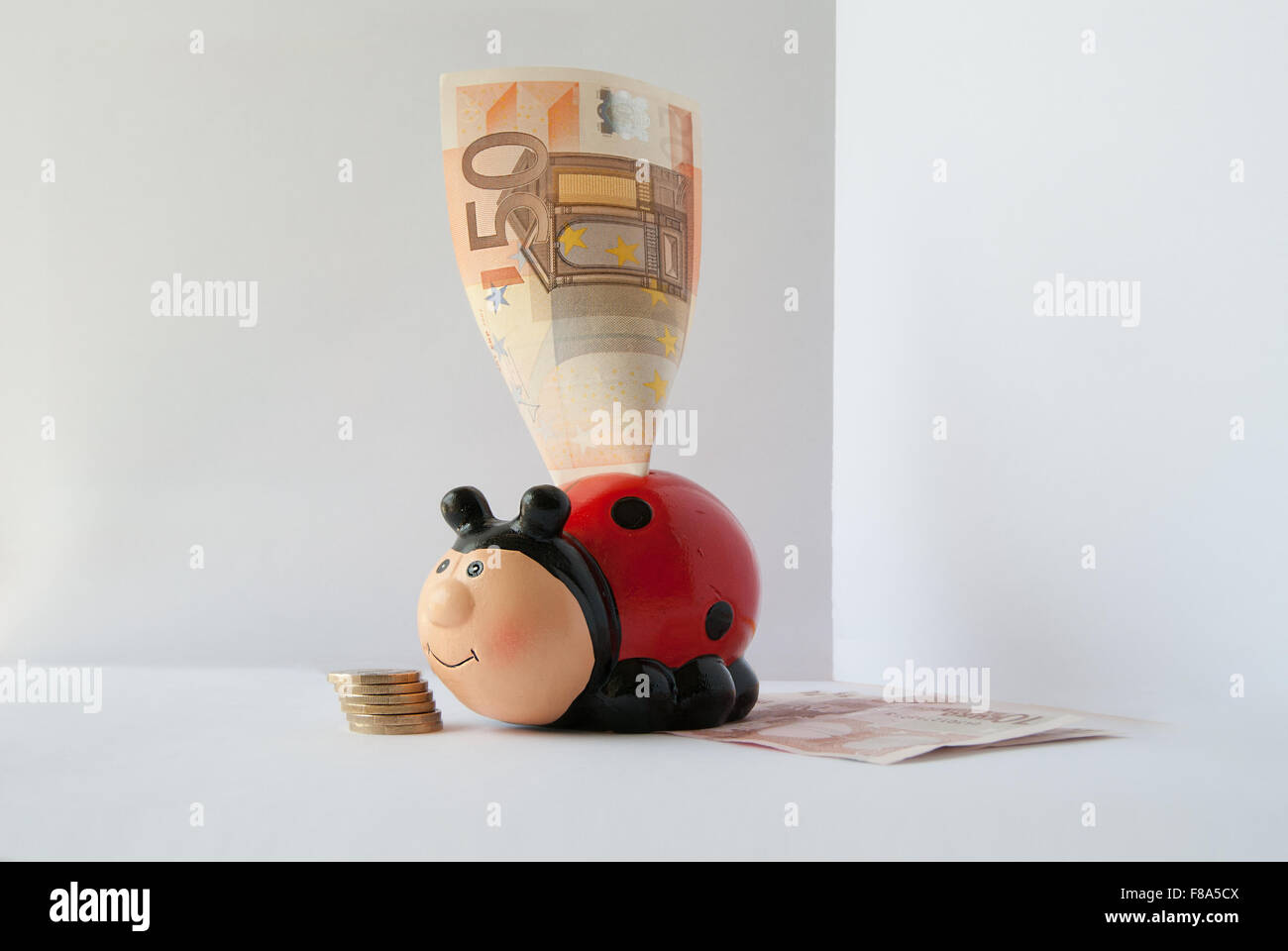 Piggy Bank for money in form of red ladybug - Stock Image