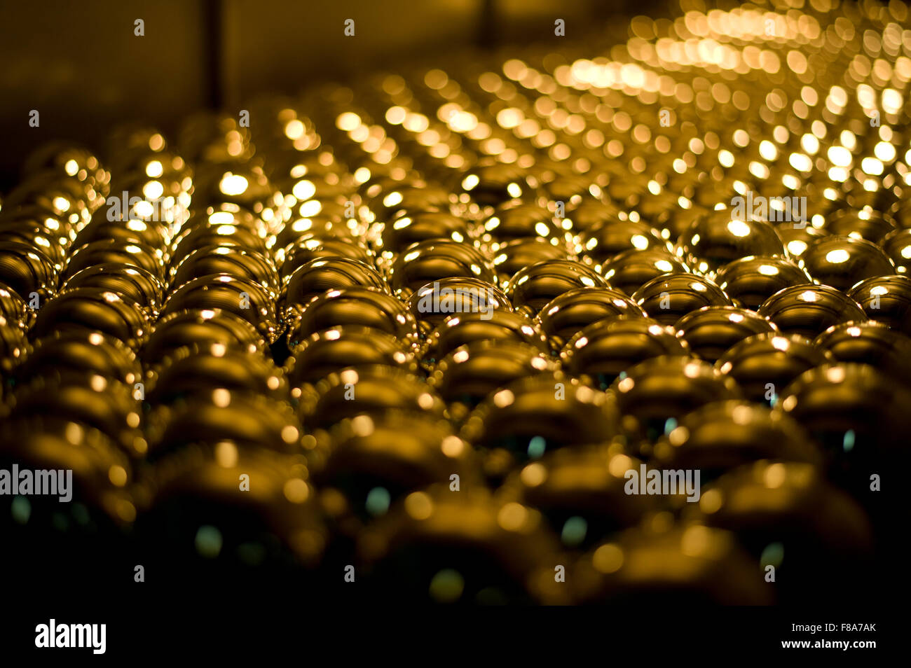 Piotrkow Trybunalski, Poland. 7th December, 2015. Silvered glass balls arranged and left to dry out in drying machine - Stock Image