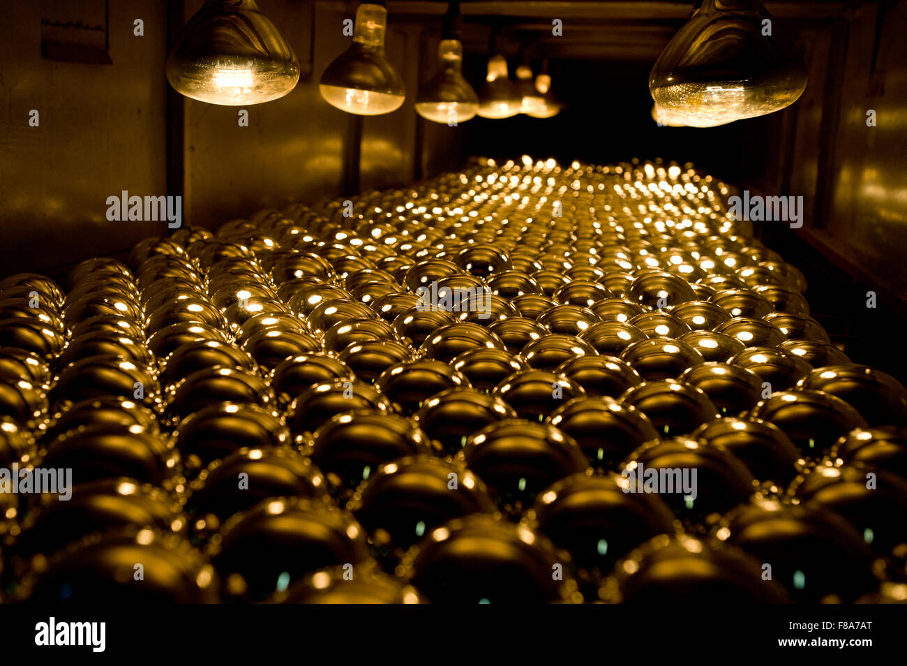 Piotrkow Trybunalski, Poland. 7th December, 2015. Silvered glass balls arranged inside of drying machine at 'Szkło - Stock Image